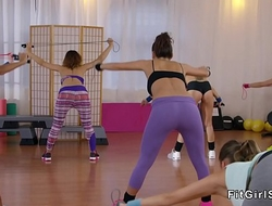 Three horny lesbians toying at gym