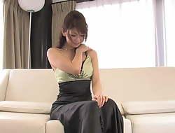 Japanese beauty sucks and titty fucks hard dick