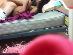 Indian Girl making out relative to Boy on Cot